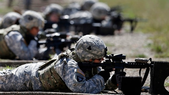 In this Sept. 18, 2012, file photo, female soldiers from 1st Brigade Combat Team, 101st Airborne Division train on a firing range while testing new body armor in Fort Campbell, Ky. (Mark Humphrey/AP)