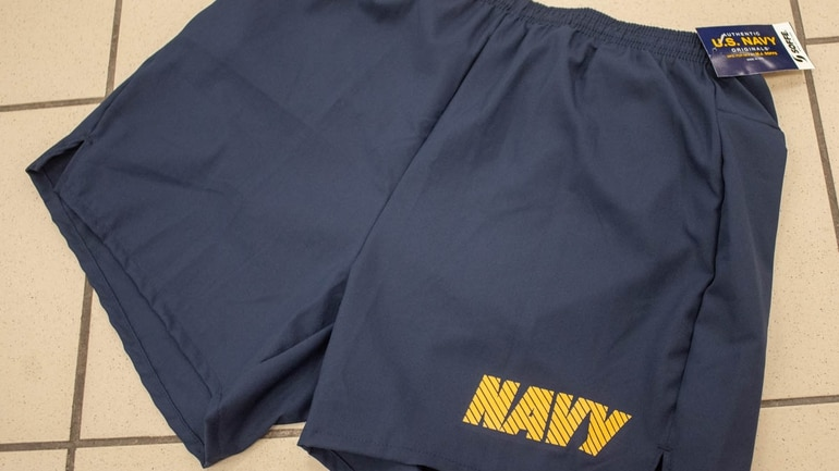 b51ab3e83adb7 4 of 6 The Navy's new physical training uniform shorts have a five-inch  inseam and a zippered