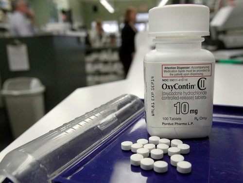 OxyContin, an opioid, is shown at a pharmacy. Opioid prescription rates have decreased within the Military Health System. (Toby Talbot/AP)