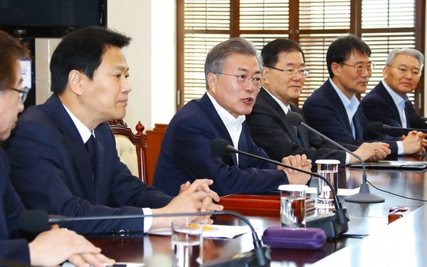 South Korean President Moon Jae-in, fourth from right, speaks during a meeting to prepare a planned summit between South and North Korea at the presidential Blue House in Seoul, South Korea, Wednesday, March 21, 2018. (Bee Jae-man/Yonhap via AP)