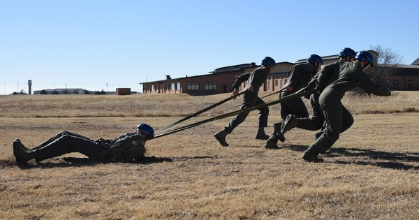Students from the Pilot Training Next Program conduct drag training at Sheppard Air Force Base, Texas, March 2. This training simulates a parachute dragging the pilot on the ground after landing. (Senior Airman Robert McIlrath/Air Force)