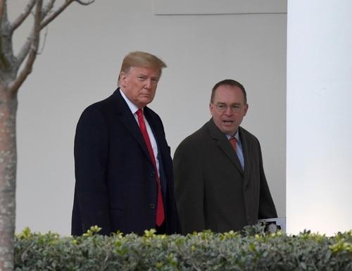 President Donald Trump, left, and acting White House chief of staff Mick Mulvaney, right, walk along the colonnade of the White House in Washington, Monday, Jan. 13, 2020. (Susan Walsh/AP)