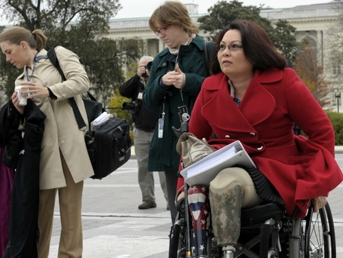 Sen. Tammy Duckworth, D-Ill., who lost both legs in combat before turning to politics, near the Capitol in Washington. (Susan Walsh/AP)