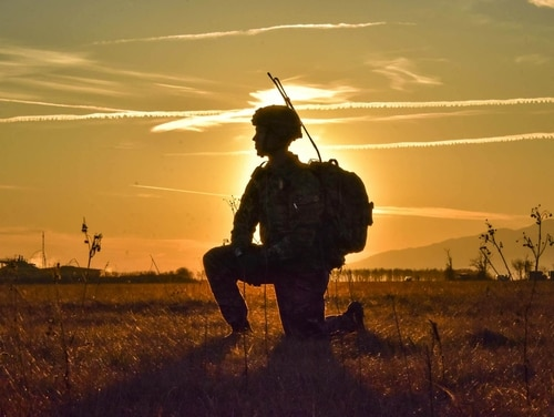 A paratrooper stands watch as paratroopers conduct an airborne insertion onto Juliet Drop Zone in northern Italy Jan. 18, 2018. (Lt. Col. John Hall/Army)