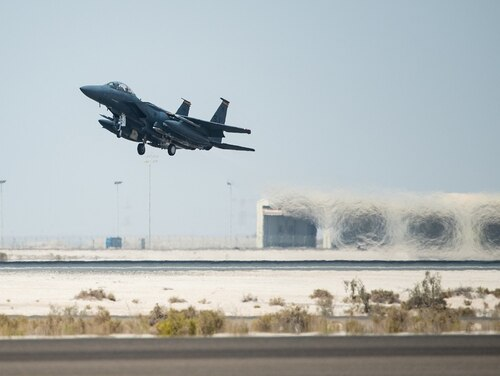 An F-15E Strike Eagle assigned to the 336th Expeditionary Fighter Squadron takes off for Agile Strike Sept. 18 at Al Dhafra Air Base, United Arab Emirates. The 336th EFS sent two aircraft and personnel to operate missions out of Prince Sultan Air Base, Saudi Arabia. (Staff Sgt. Chris Thornbury/Air Force)