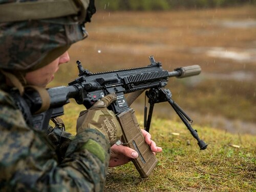 U.S. Marines with 3rd Battalion 8th Marine Regiment fire the M27 Infantry Automatic Rifle during a live-fire weapons exercise at range F-18 on Camp Lejeune, N.C., Dec. 8, 2017. The M27 has been introduced to different units throughout the Marine Corps within the last six months. (U.S. Marine Corps photo by Lance Cpl. Michaela R. Gregory)