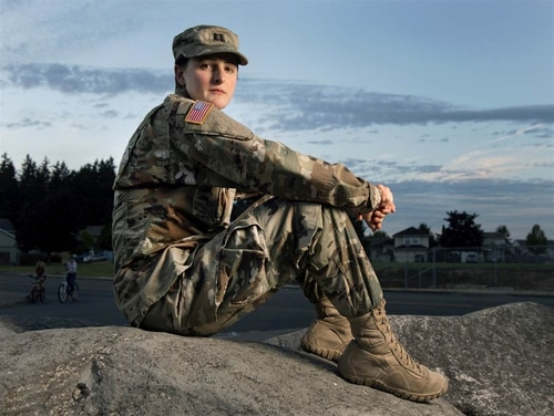 In this photo taken on Aug. 28, 2015, Capt. Jennifer Peace poses near her home in Spanaway, Wash. Peace is one of an estimated 15,000 transgender people who serve in the active-duty military. She's speaking out in the hopes of helping people understand transgender men and women. (Drew Perine/The News Tribune via AP)