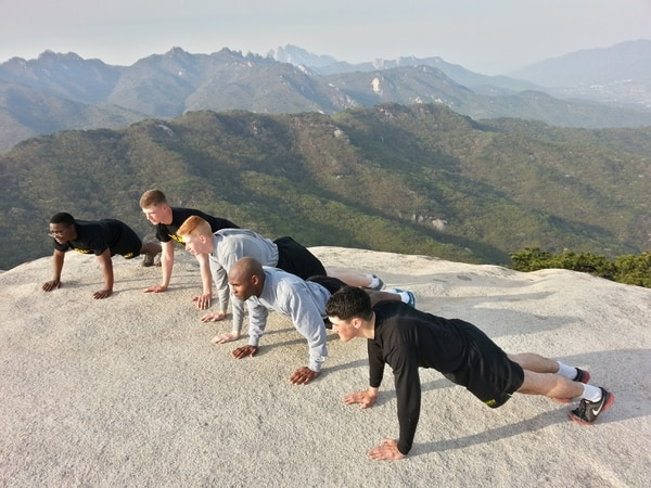 Soldiers getting ready to do 50 push ups at the top of a 1,500 foot mountain in Korea. The run was a total of six miles, three miles up and three miles down and back to base. The Soldiers pictured are all members of Company A, Headquarters and Headquarters Battalion, 2nd Infantry Division. From left to right is Pfc. KawarrenDraper, Pfc. Collin Davis, Pfc. Dakota Stratton, Spc. Renel Thalamour and Pfc. Jordan Serrano. The photo was taken April 23, 2015. The lack of PT belts is because in the Second Infantry Division does not require Soldiers to wear them for PRT. CREDIT: Master Sgt. Jason B. Baker, 2ID G7 Operations NCO