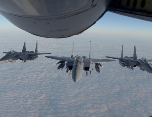 Three U.S. Air Force F-15E Strike Eagles aircraft, assigned to the 48th Fighter Wing, fly behind a U.S. Air Force KC-135 Stratotanker aircraft, assigned to the 100th Air Refueling Wing, during joint exercises with the Swedish armed forces Nov. 13. (Senior Airman Benjamin Cooper/Air Force)