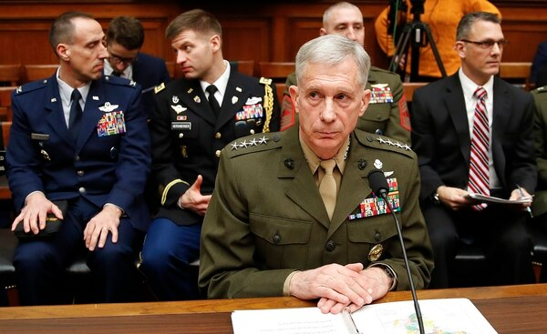 Marine Gen. Thomas Waldhauser takes his seat before testifying at a hearing before the House Armed Services Committee on Capitol Hill in Washington, Tuesday, March 6, 2018, about