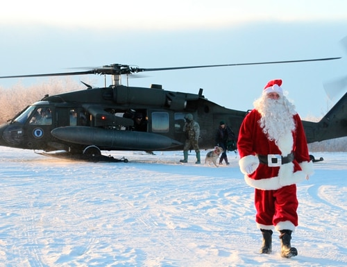 This Dec. 3, 2019, photo shows Santa Claus arriving in Napakiak, Alaska, on an Alaska National Guard UH-60 Black Hawk helicopter. (Mark Thiessen/AP)