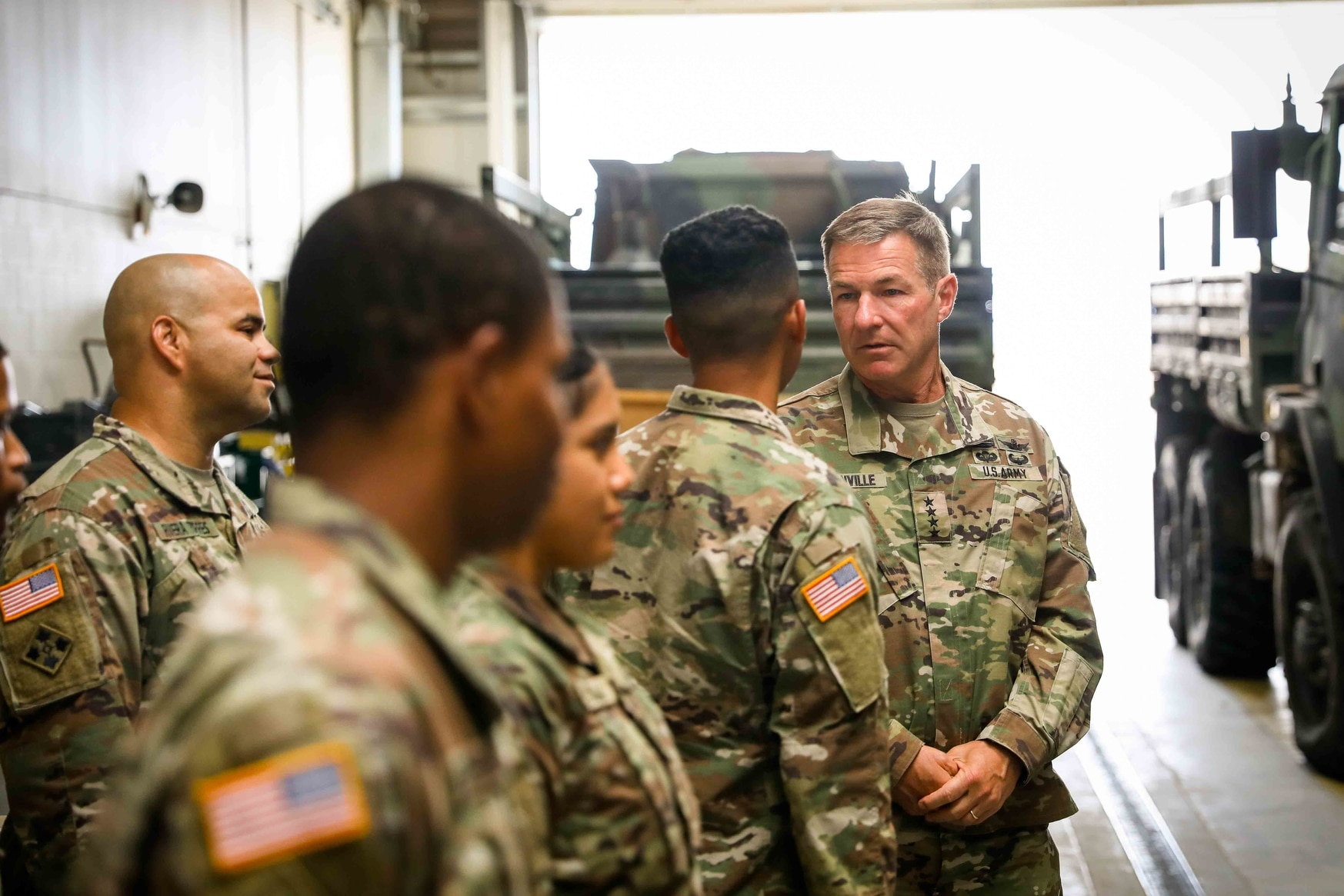 Gen. James C. McConville, right, visits soldiers at Fort Bliss, Texas, in July. (Spc. Matthew J. Marcellus/Army)