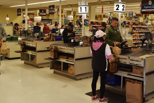 Commissary customers pay for their groceries in the checkout lanes at Langley Air Force Base, Virginia. (Defense Commissary Agency)