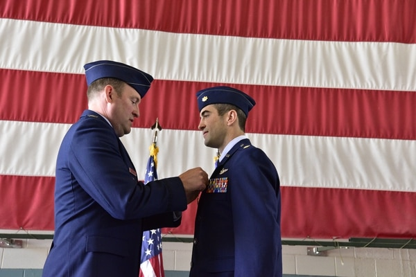 Col. Bradley Downs, vice commander of the 492nd Special Operations Wing, pins the Distinguished Flying Cross on Maj. Michael Tolzien, 58th Special Operations Wing, during a ceremony at Kirtland Air Force Base, July 6. (Air Force)