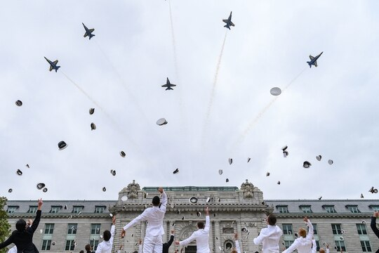 The U.S. Navy Flight Demonstration Squadron, the Blue Angels, fly over Bancroft Hall as midshipmen toss their covers concluding the fifth swearing-in event for the United States Naval Academy Class of 2020 on May 20 in Annapolis, Md. (MC2 Dana D. Legg/Navy)