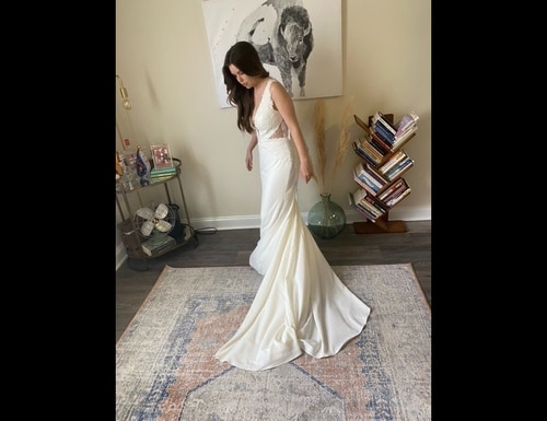 A model wears one of the free gowns offered in the Operation Deploy Your Dress: Bridal, in a new program for the military community. She was a 'pilot bride' who tested the process. (Courtesy Operation Deploy Your Dress)
