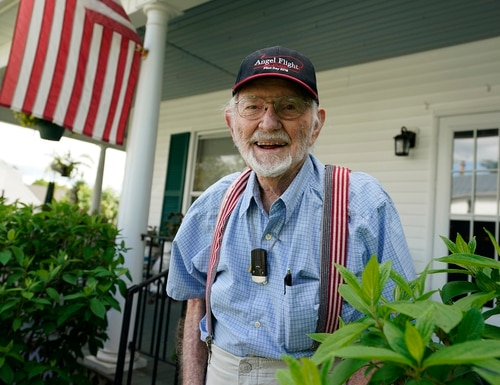Former WWII bomber pilot and commercial airline pilot, John Billings, in front of his home in Woodstock, Va., on May 5, 2021. (Steve Helber/AP)