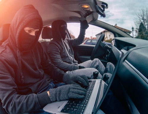 Car thief disarming car protections with laptop computer