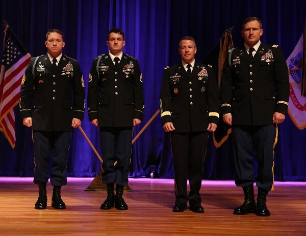 Staff Sgt. Michael Young, second from left, was awarded the Silver Star medal for his actions in April 2017 on a raid with C Company, 3rd Battalion, 75th Ranger Regiment. Shown from left are 3/75 Command Sgt. Maj. Brett Johnson; Young; Lt. Gen. Austin S. Miller, commander of Joint Special Operations Command; and Lt. Col. Michael Kloepper, commander of 3rd Ranger Battalion. (Spc. David Soflin/Army)