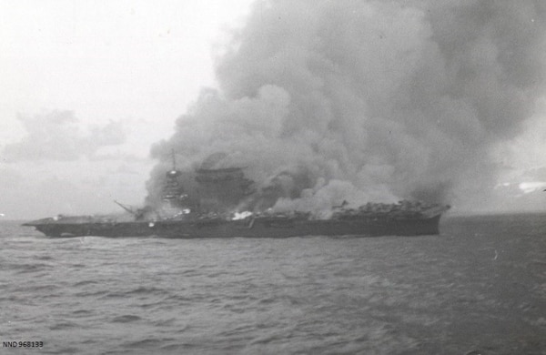 The aircraft carrier Lexington after all hands had abandoned ship. Fires sweep the deck and superstructure. (National Archives)