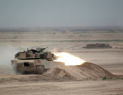 An M1 Abrams main battle tank engages a target with its 120 mm main gun. (Sgt. Kevin Bromley/Army)