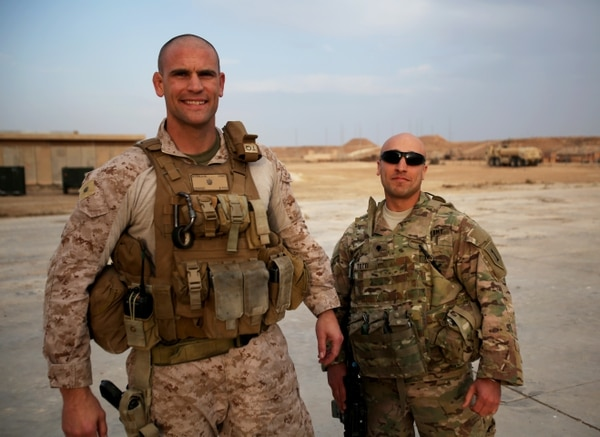 U.S. Marine Maj. Brandon Stibb, left, a training team leader, and U.S. Army Spc. Ahmed Totti, right, a linguist and cultural advisor, both with Task Force Al Asad, pose for a photo together aboard Al Asad Air Base, Iraq, Jan. 17, 2015. During a deployment to Iraq in 2009, then captain Stibb befriended Totti while he acted as an interpreter with U.S. forces before traveling to the United States, gaining citizenship, and enlisting in the U.S. Army. (Courtesy photo/RELEASED)