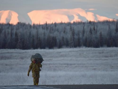 A paratrooper walks off Malemute Drop Zone at Joint Base Elmendorf-Richardson, Alaska. (Army photo/John Pennell)