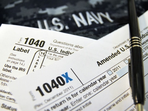 Tax help is one of the free services that is now available for service members for up to a year after they leave the military through Military OneSource. (MC1 Patrick Gordon/Navy)