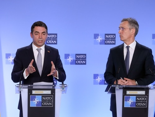 Macedonian Foreign Minister Nikola Dimitrov, left, speaks as NATO Secretary General Jens Stoltenberg listens during a joint news conference after the signature ceremony of the accession protocol between North Macedonia and NATO on Feb. 6, 2019. (Francois Walschaerts/AFP via Getty Images)