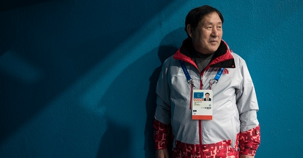 Lee Gyeong Pil waits for spectators to arrive at one the entrances of the Gangneung Curling center at the 2018 Winter Olympics in Gangneung, South Korea, Saturday, Feb. 24, 2018. Lee was among five babies born on an American ship that ferried thousands of Korean refugees from North Korea during the Korean War. Nicknamed by U.S. crew as Kimchi 1 through Kimchi 5, they've become a symbol of the South Korea-U.S. military alliance. Lee, Kimchi 5, and his friend Sohn Yang Young, Kimchi 1, were in Gangneung to volunteer for the Olympics as part of their efforts to promote peace and remind younger generations of the lessons of the Korean War. (Felipe Dana/AP)