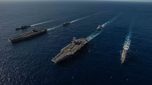 Ships with the Ronald Reagan and John C. Stennis carrier strike groups transit the Philippine Sea during dual carrier operations Nov. 16. The Navy's plan to build a gigantic fleet may be under pressure with new cuts in the offing. (MC2 Kaila Peters/Navy)