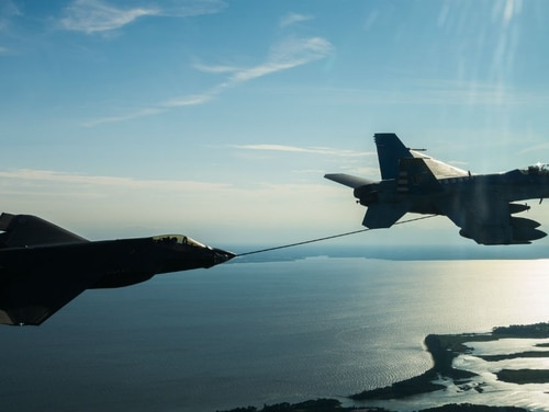 The U.S. Navy envisions an air wing of fourth-generation Super Hornets and fifth-generation F-35 Joint Strike Fighters into the 2030s. (U.S. Navy)