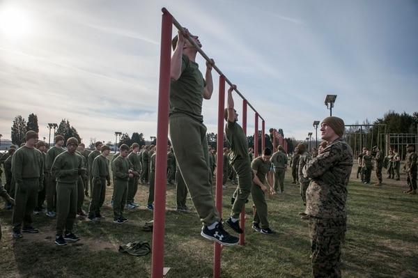 Marine Officer Candidates from Charlie and Delta Company attending Officer Candidate Class-220 complete their initial Physical Fitness Test (PFT) at Brown Field aboard Marine Corps Base Quantico, Va., Jan. 20, 2016. The PFT events for all male candidates and Marines consist of a timed 3-mile run, pull-ups for maximum repetitions, and crunches for maximum repetitions within a two-minute time period. The mission of Officer Candidates School (OCS) is to