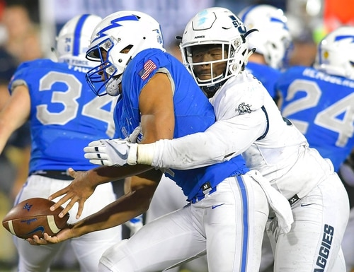 Air Force quarterback Isaiah Sanders (4) pitches the ball before getting tackled by Utah State defensive end Devon Anderson (91) during an NCAA football game, Saturday, Sept. 22, 2018, in Logan, Utah. (Eli Lucero/Herald Journal via AP)