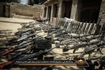 Taliban propaganda showcases US weapons and radios as captured war spoils