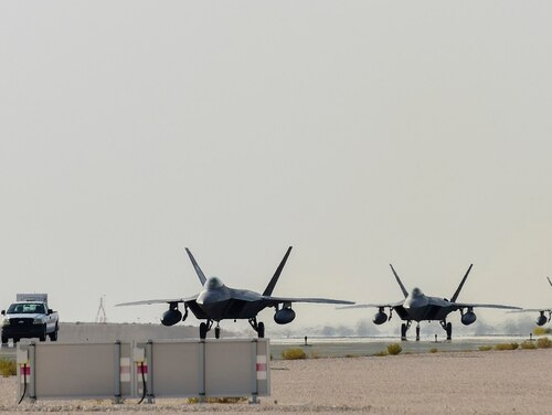 Air Force F-22 Raptors arrive at Al Udeid Air Base, Qatar, June 27. The aircraft are deployed to Qatar for the first time to defend American forces and interests in U.S. Central Command. (Tech. Sgt. Nichelle Anderson/Air Force)