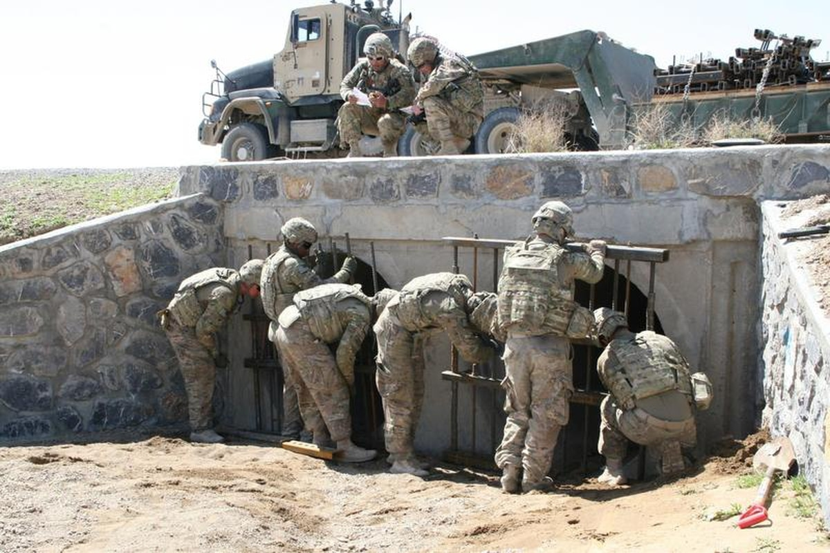 US Army Soldiers With The 65th Engineer Battalion Install Culvert Denial Systems Along Highway 1 In Helmand Province Afghanistan March 24 2014