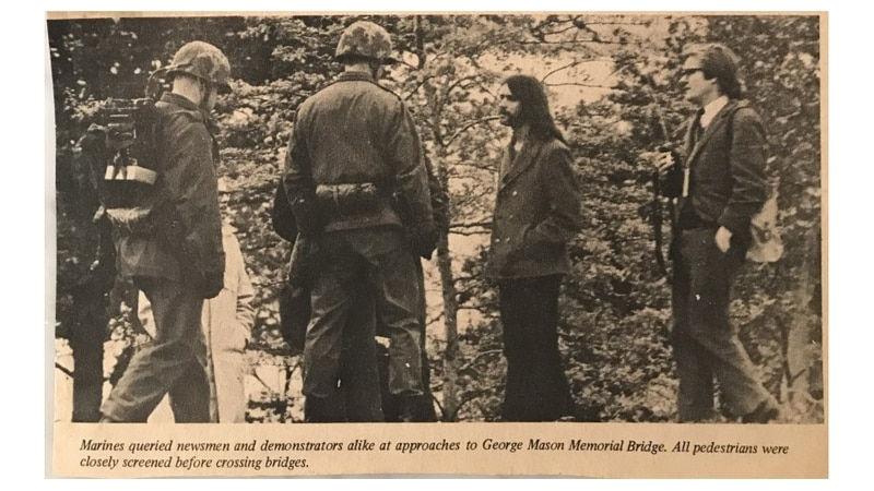 "The Quantico Sentry newspaper caption reads: ""Marines queried newsmen and demonstrators alike at approaches to George Mason Memorial Bridge. All pedestrians were closely screened before crossing bridges."" (Courtesy of David Nelson)"
