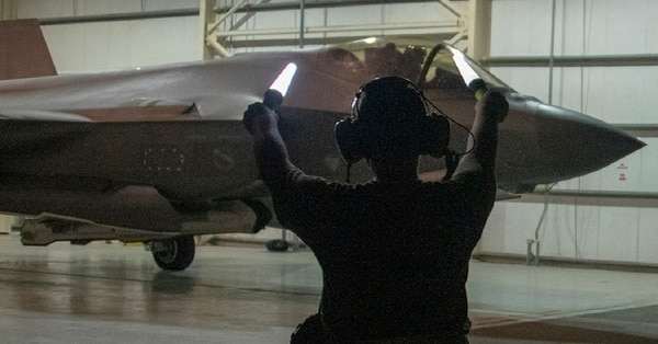 U.S. Air Force Capt. Emily Thompson launches an F-35A Lightning II while Airman 1st Class Ashlin Randolph gives the signal to proceed on the flightline of the Al Dhafra Air Base in the UAE. (Tech. Sgt. Kat Justen/U.S. Air Force)