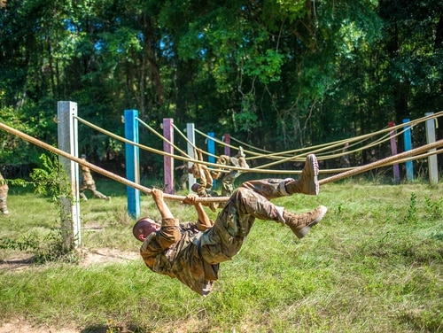 Trainees from Delta Company, 2nd Battalion, 19th Infantry Regiment, train on the Sand Hill Obstacle Course at Fort Benning, Georgia. (Patrick A. Albright/Army)