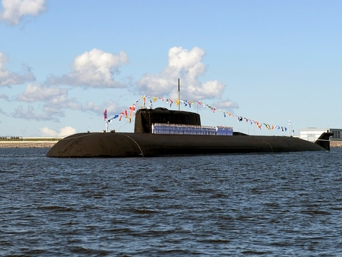 The Russian nuclear-powered cruise missile submarine K-266 Orel attends the military parade during the Navy Day celebration in Kronshtadt outside St. Petersburg, Russia, Sunday, July 26, 2020. (Alexei Druzhinin/Sputnik, Kremlin Pool Photo via AP)