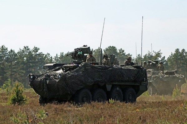 Soldiers assigned to F Troop, 2nd Squadron, 2nd Cavalry Regiment move into position in Stryker Armored Fighting Vehicles as they conduct a demonstration for Latvian military families during the Latvian Battalion anniversary, May 28, 2017, at Adazi Military Base, Latvia. (Sgt. Paige Behringer/Army)