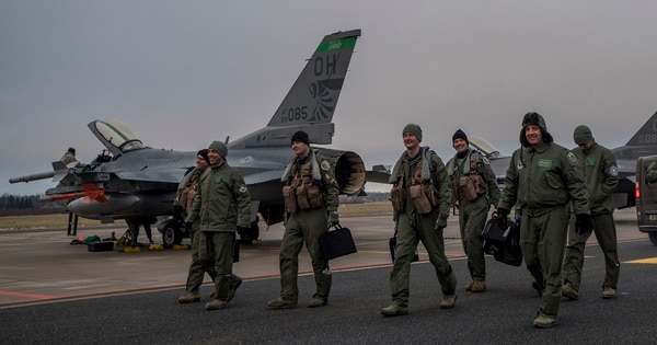 F-16 pilots from the 180th Fighter Wing, Ohio Air National Guard, walk toward the terminal at Amari air base, Estonia, Jan. 14. They flew missions in support of U.S. partners and allies in the European theater. (MC3 Cody Hendrix/DoD)