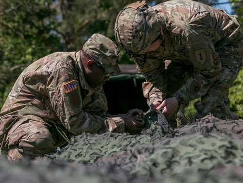Army researchers and industry are testing prototypes for new camouflage netting that would conceal soldiers and equipment from sight and sensors. Three industry partners were awarded contracts to develop the models. One will be selected next year. (Spc. Dustin D. Biven/Army)