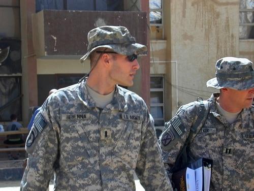 1st Lt. Michael C. Behenna, left, and his defense attorney Capt. Tom Clark, right, walk in Camp Speicher, a large U.S. base near Tikrit, north of Baghdad, Iraq, on Sept. 21, 2008. (Vanessa Gera/AP)