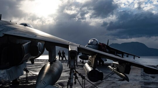 AV-8B Harrier pilots observe the scenery from the flight deck of the Wasp-class amphibious assault ship Kearsarge (LHD-3), Jan. 10 as it departs Souda Bay, Greece, after a port visit. (Mass Communication Specialist 1st Class Mike DiMestico/Navy)