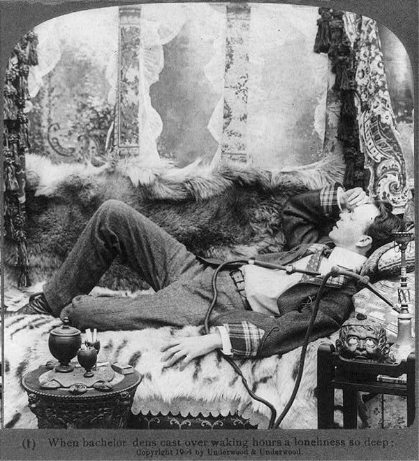 Young man with opium pipe reclining on a sofa covered with furs, c1904. (Underwood & Underwood stereograph card, now in the Library of Congress)