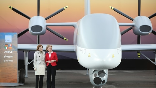 German Defence Minister Ursula von der Leyen, right, and French Armed Forces Minister Florence Parly stand next to a mock-up of the European MALE drone at the ILA Berlin Air Show on April 26, 2018, in Schoenefeld, Germany. (Sean Gallup/Getty Images)