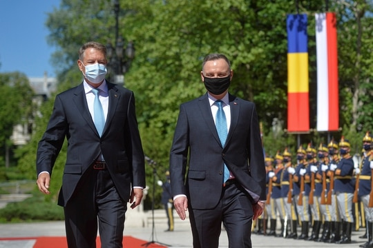 Polish President Andrzej Duda, right, reviews the honor guard with Romanian President Klaus Iohannis during the welcoming ceremony at the Cotroceni presidential palace in Bucharest, Romania, Monday, May 10, 2021. (Alexandru Dobre/AP)