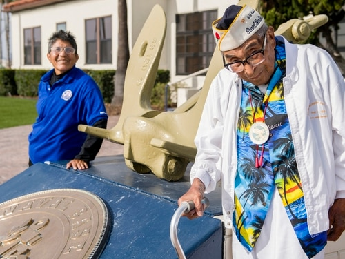 Ray Chavez, the oldest living Pearl Harbor survivor and his daughter Kathleen Chavez, last year attended a naval heritage event to remember Pearl Harbor at Naval Base San Diego. He died on Wednesday at the age of 106. (MC3 Reymundo A. Villegas III/Navy)
